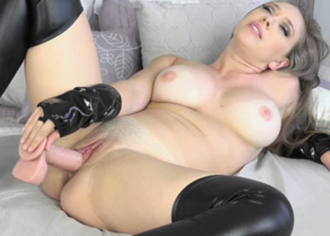 Kagney fucks her twat with a big toy